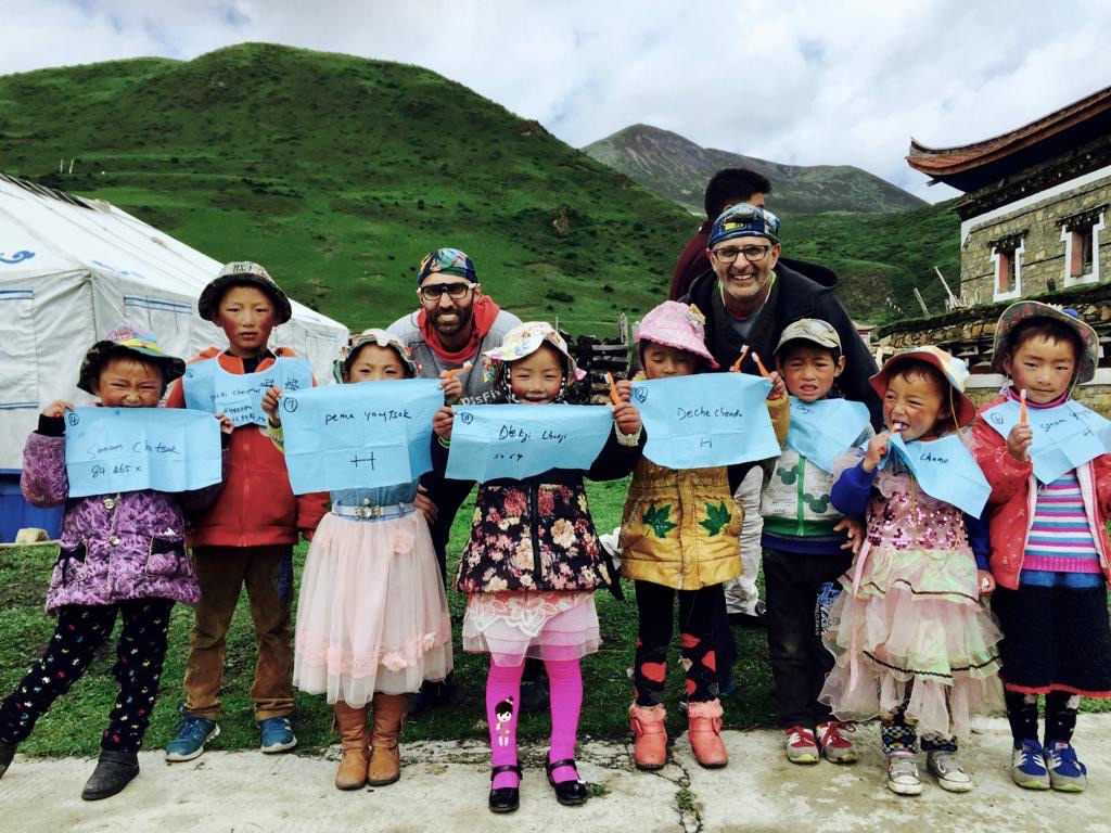 Dr. Mebs Sayani and Dr. Jan Jaffer from Ranchlands Dental posing with children in Tibet