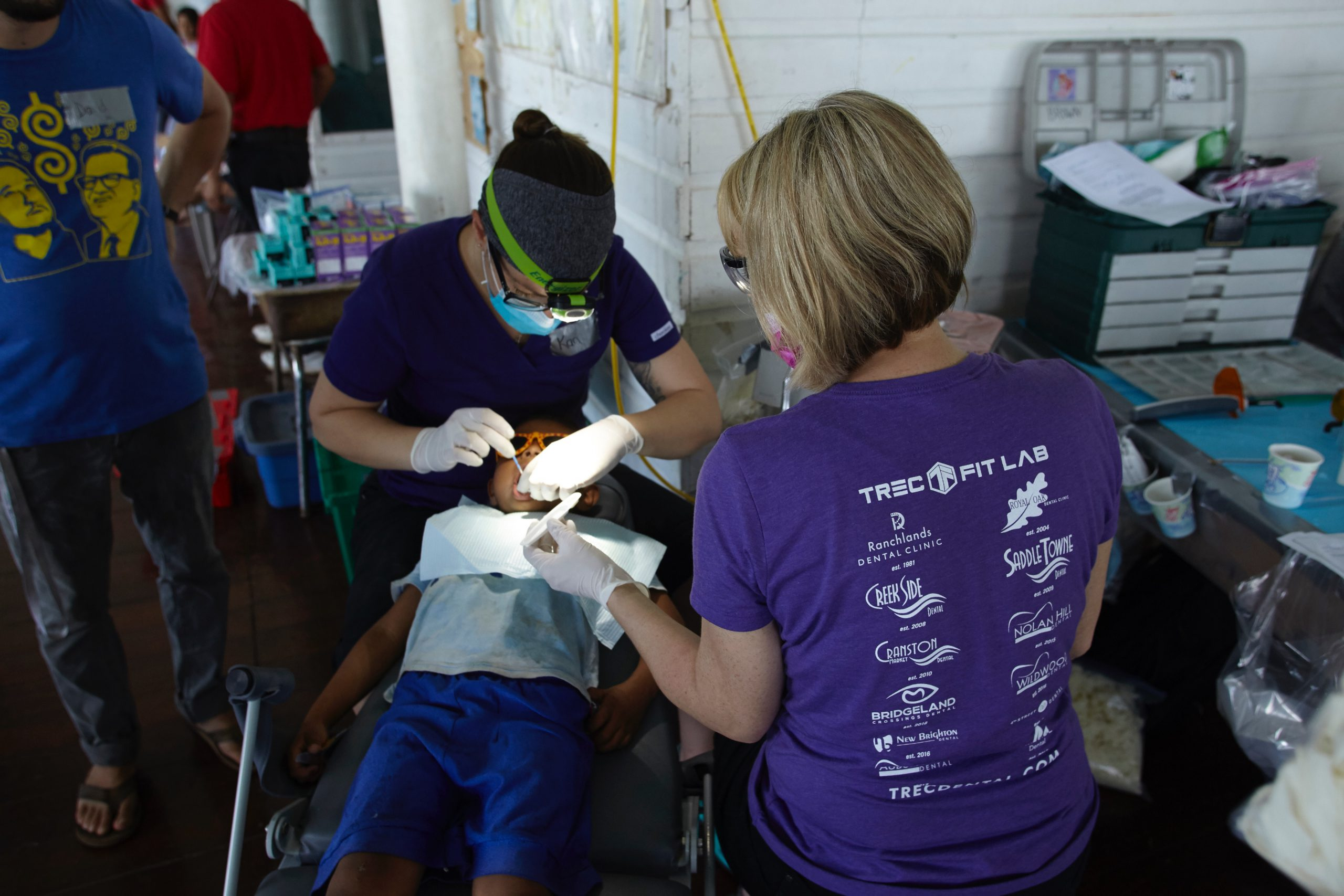 Moving Dental team working on patient